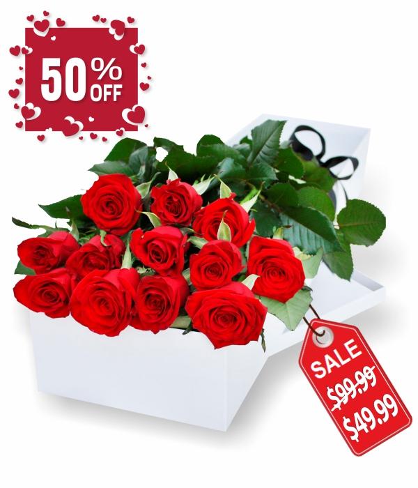 Douzaine de roses rouges en boîte